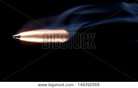 Black polymer tip on a copper plated bullet with smoke