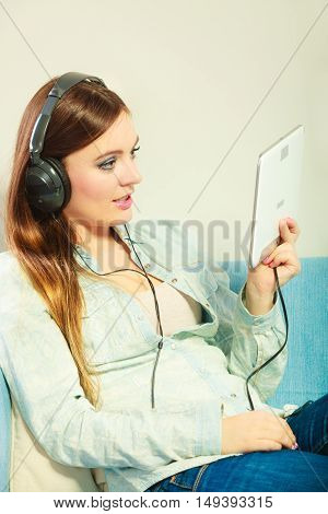 Woman With Tablet Headphones Relaxing