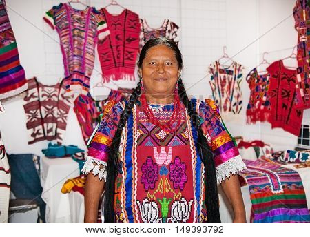 OAXACA MEXICO- DECEMBER 7, 2015: Mexican women selling handicrafts and carpets in Oaxaca on December 7, 2015, Mexico.