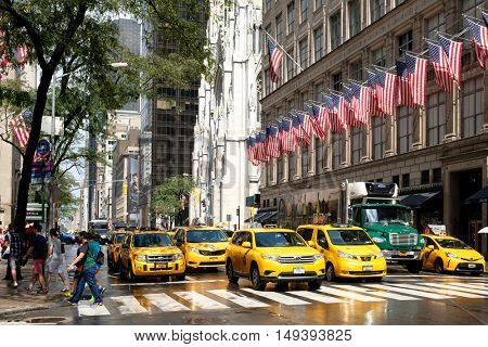 NEW YORK,USA - AUGUST 20,2016: Yellow cabs next to Saint Patrick's Cathedral and Saks Fifth Avenue in New York City