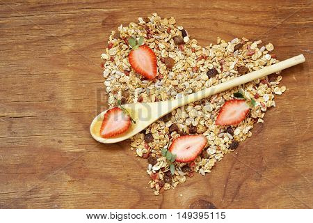 healthy eating granola cereal with nuts and fruit, in the shape of a heart