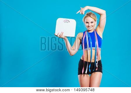 Fit Woman With Measure Tape With Weight Scale