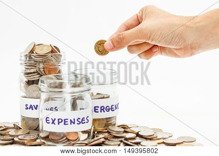 Coins Stack And Hand Holding The Coin,finance Concept On White Background And Selective Focus.