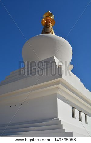 Dome of the Stupa with blue sky background.