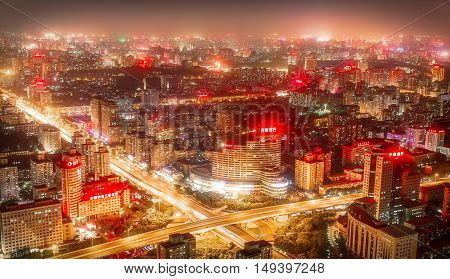 BEIJING - CHINA, MAY 2016: Top view from Central Radio TV Tower over the big asian city of Beijing. China at nighttime when the tall skyscrapers are illuminated on May 18, 2016.