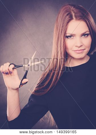Elegance and classy. Fashion style of hairdo. Female professionalist with scissors. Elegant woman presents her hairdresser's saloon.