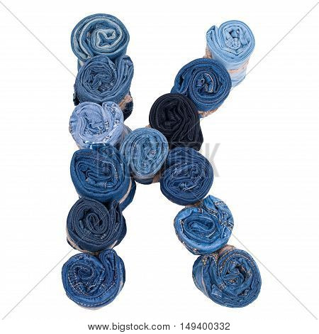 Letter K made of jeans roll on a white background