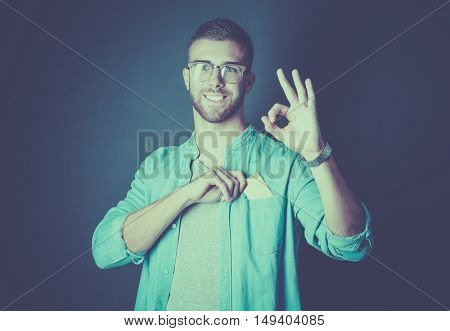 Man holding a credit card and showing ok