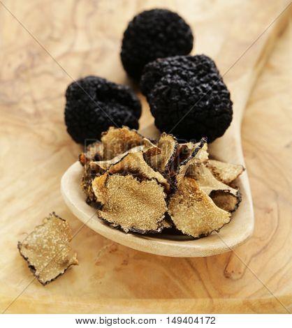 gourmet mushroom black truffle fresh and dry on wooden background