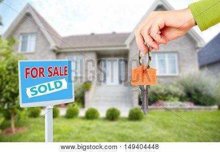 Hand with a house keys.