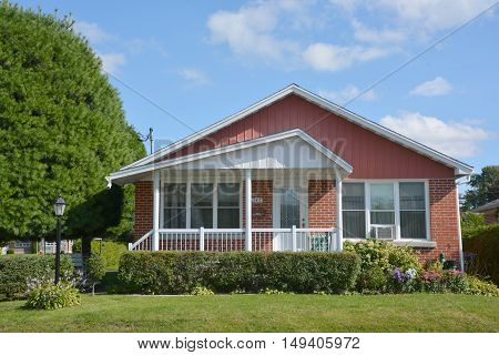 GRANBY QUEBEC CANADA 09 28 2016: Typical 70s Bungalow house is a type of building, originally from Bengal region in South Asia, but now found throughout the world.