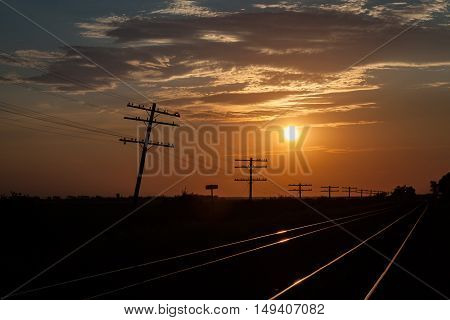 Silhouetted Telegraph Lines in a Golden Sunrise