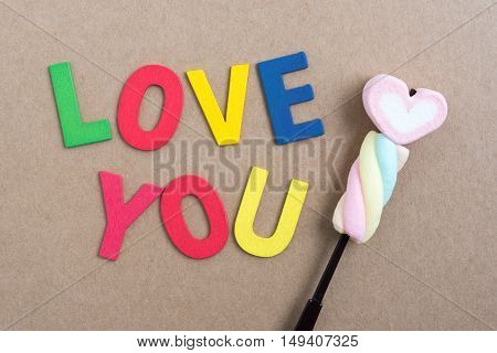 Colorful words love you with valentines candy