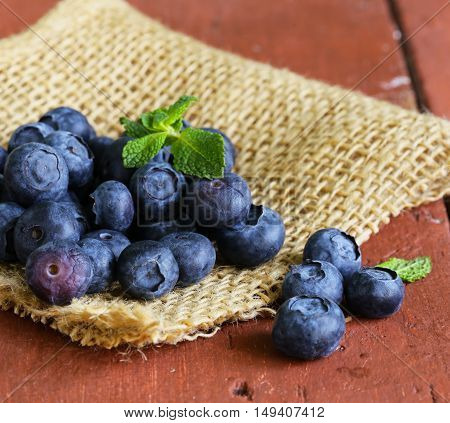 fresh organic blueberries on a wooden table