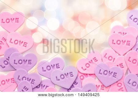 Valentine's Day heart shaped candy on blur background with bokeh light