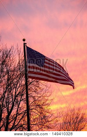 american flag with brillant sunset in background