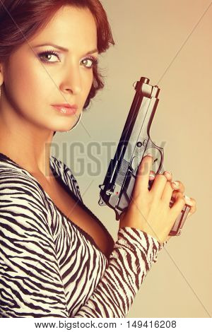 Beautiful latin woman holding gun