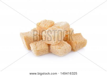 stack of croutons from white bread on white background