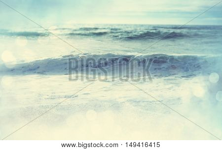 The wave on the beach. Blur background and sunny light. Peaceful nature background.