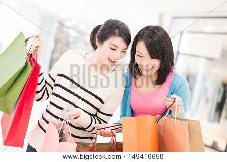 Happy woman shopping in the mall shot in hong kong asian