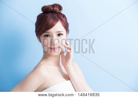 beauty woman smiling to you isolated on blue background asian