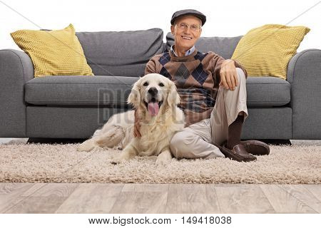 Mature man sitting on the floor with his dog and looking at the camera isolated on white background