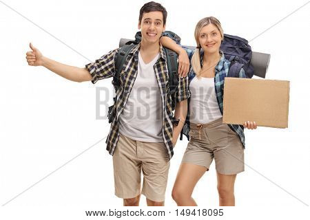 Cheerful hikers hitchhiking and holding a blank cardboard sign isolated on white background