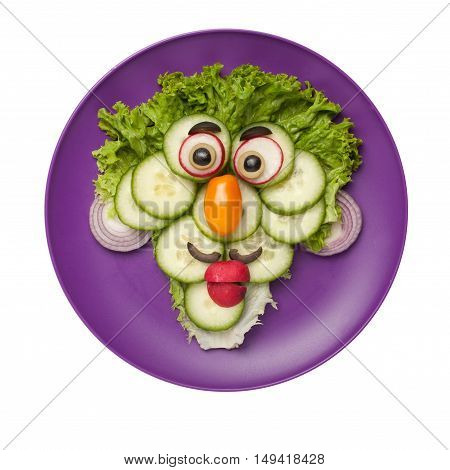 Funny face made of vegetables on plate