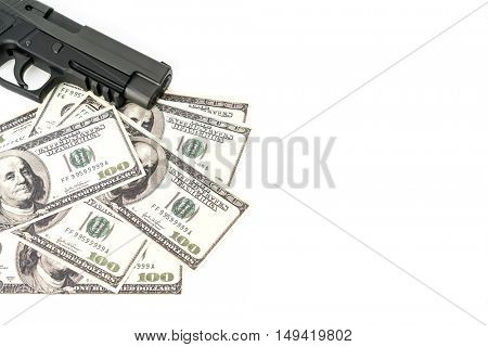 Close up image of pistol and dollar