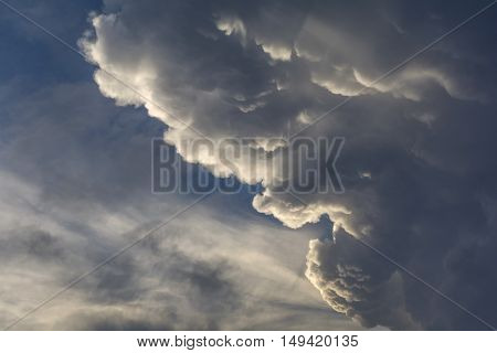 Angry clouds shape.Furious man face. Dramatic cloudscape area background.