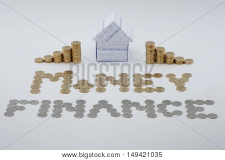 House And Split Step Pile Of Gold Coins