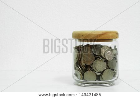 Coin stacks on wooden table with cement background business concep