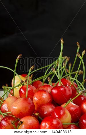 handful of ripe sweet cherries on a table