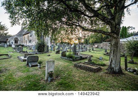 Tetbury UK - August 15 2015: Churchyard of St Saviour Church. Outdoor view at sunset.