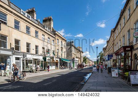 Bath UK - August 15 2015: Commercial street near Pulteney Bridge in Bath