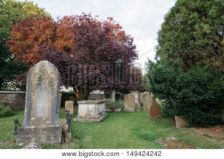 Tetbury UK - August 15 2015: Old churchyard at sunset in St. Mary The Virgin church.