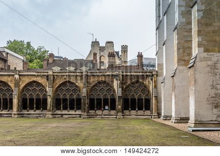 Cloister of The gothic Westminster Abbey in London UK. Cloudy day.