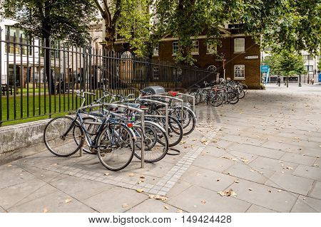 LONDON UK - AUGUST 21 2015: Parking for Bicycles in London with steel bars to lock bikes to.
