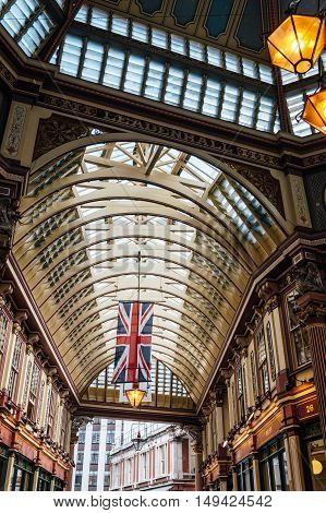 LONDON UK - AUGUST 21 2015: Low angle view of the interior of Leadenhall Market. Leadenhall Market is one of the oldest markets in London.
