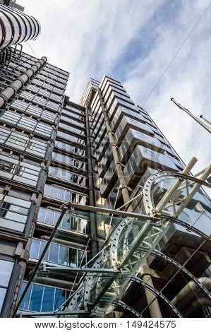 LONDON UK - AUGUST 21 2015: Low angle view of the entrance of Lloyds building - home of insurance institution Lloyd of London. Like Pompidou Centre in Paris was designed by Rogers and completed on 1986.