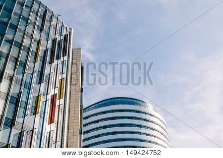 LONDON UK - AUGUST 22 2015: Low angle view of modern office buildings in London.