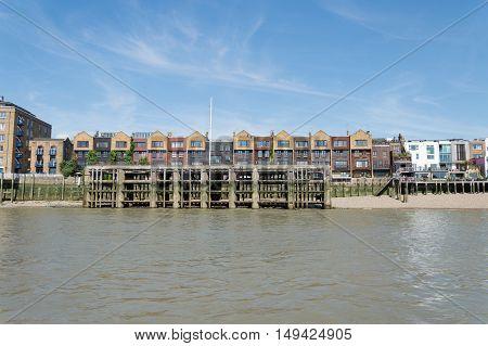 LONDON UK - AUGUST 22 2015: Housing in London riverside near Canary Wharf