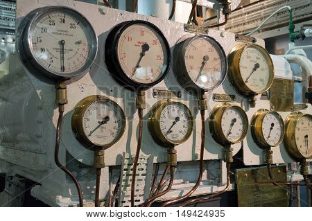 LONDON UK - AUGUST 22 2015: Detailed view of many manometers inside of the Royal Navy warship HMS Belfast in London.