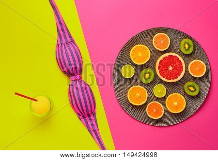 Fashion. Tropical Summer Set. Fashion Design. Bright Color. Fashion Stylish Accessories. Top View. Fruit Creative Art Concept. Citrus. Fashion Glamor woman Swimsuit Bikini. Minimal Concept. Top View