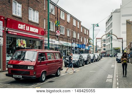 LONDON UK - AUGUST 23 2015: Brick Lane is a street in east London It is famous for its many curry houses and for being a vibrant art and fashion area