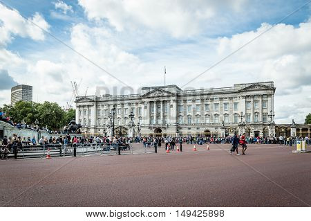 London UK - August 19 2015: People waiting for traditional Changing of the Guards ceremony near Buckingham Palace. This is one of the most popular tourist attractions in London.