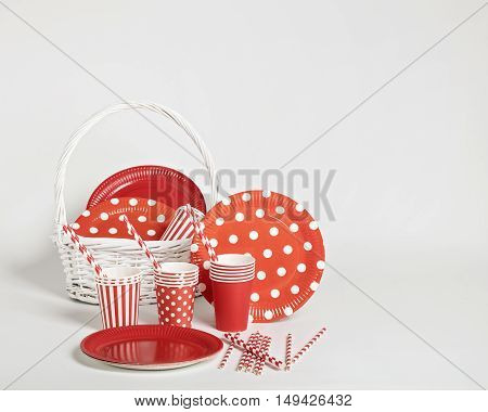 Red disposable tableware for parties and picnics. Selective focus.