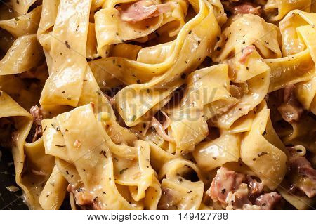 Close-up Of Pappardelle Pasta With Prosciutto And Cheese Sauce