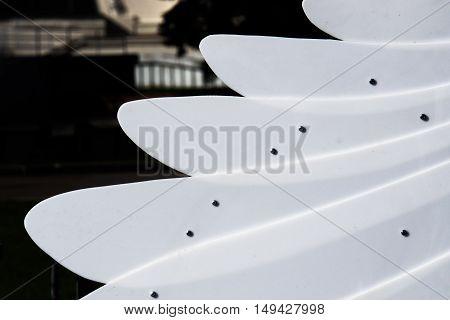 white plastic wings, white background, black background