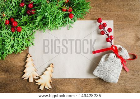 Xmas decoration with blank postcard on wooden background. Copy space. Merry christmas. Selective focus space for text.